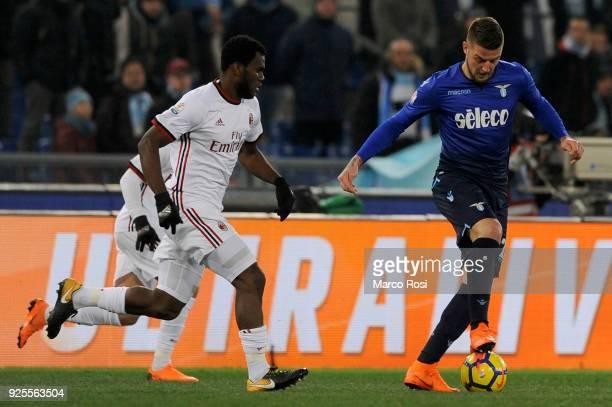 Sergej Milinkovic Savic of SS Lazio compete for the ball with Franck Kessie of AC Milan during the TIM Cup match between SS Lazio and AC Milan at...