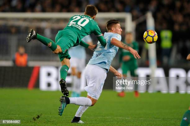 Sergej Milinkovic Savic of SS lazio compete for the ball with German Pezzella of ACF Fiorentina during the Serie A match between SS Lazio and ACF...