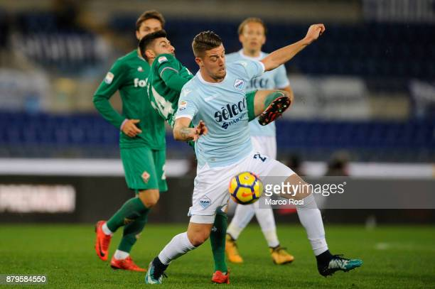 Sergej Milinkovic Savic of SS lazio compete for the ball with Marco Benassi of ACF Fiorentina during the Serie A match between SS Lazio and ACF...