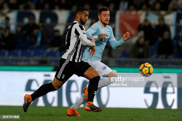 Sergej Milinkovic Savic of SS Lazio compete for the ball with Mehdi Benatia of Juventus during the serie A match between SS Lazio and Juventus at...