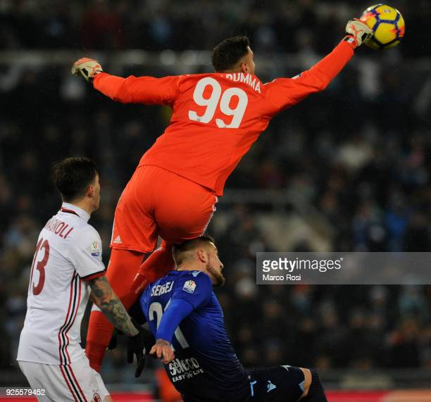 Sergej Milinkovic Savic of SS Lazio compete for the ball with Gianluigi Donnaruimma of AC Milan during the TIM Cup match between SS Lazio and AC...