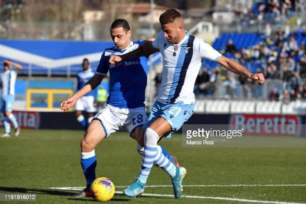 Sergej Milinkovic Savic of SS Lazio compete for the ball with Romulo of Brescia Calcioduring the Serie A match between Brescia Calcio and SS Lazio at...