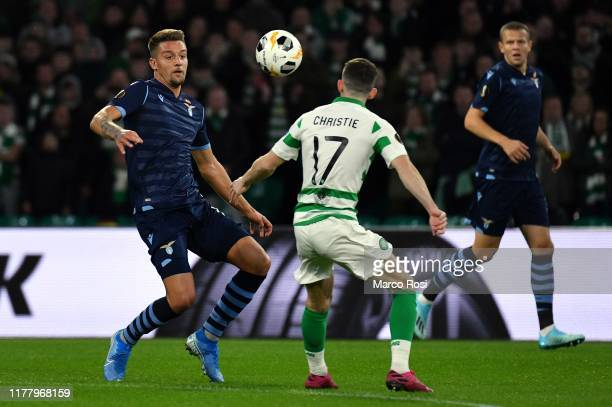 Sergej Milinkovic Savic of SS Lazio compete for the ball with Ryan Christie of Celtic FC during the UEFA Europa League group E match between Celtic...