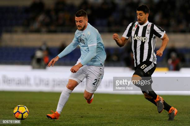 Sergej Milinkovic Savic of SS Lazio compete for the ball with Sami Khedira of Juventus during the serie A match between SS Lazio and Juventus at...