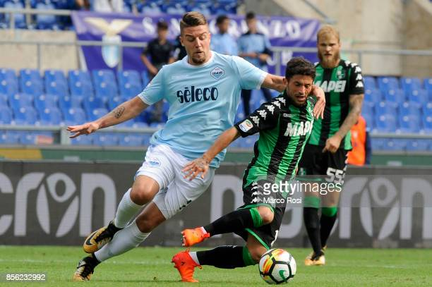 Sergej Milinkovic Savic of SS Lazio compete for the ball with Stefano Sensi of US Sassuolo during the Serie A match between SS Lazio and US Sassuolo...