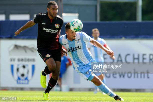 Sergej Milinkovic Savic of SS Lazio compete for the ball with Jonathan Tah of Bayer Leverkusen during the preseason friendly match between SS Lazio...