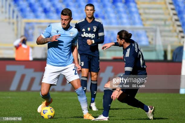 Sergej Milinkovic Savic of SS Lazio competes for the ball with Adrien Rabiot during the Serie A match between SS Lazio and Juventus at Stadio...