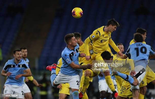 Sergej Milinkovic Savic of SS Lazio competes for the ball with Marash Kumbulla of Hellas Verona during the Serie A match between SS Lazio and Hellas...