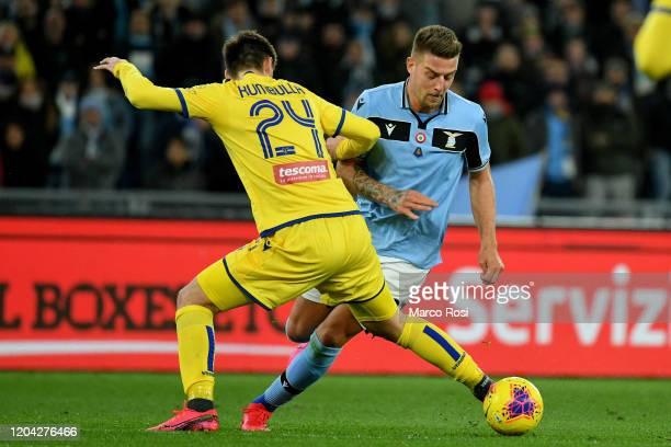 Sergej Milinkovic Savic of SS Lazio competes for the ball with Matash Kambulla of Hellas Verona during the Serie A match between SS Lazio and Hellas...