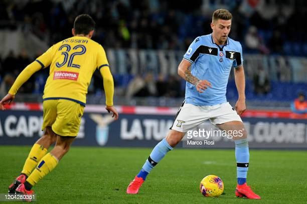 Sergej Milinkovic Savic of SS Lazio competes for the ball with Matteo Pessina of Hellas Verona during the Serie A match between SS Lazio and Hellas...