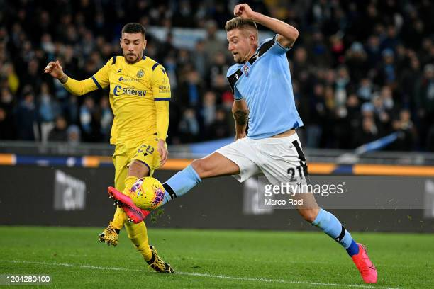 Sergej Milinkovic Savic of SS Lazio competes for the ball with Mattia Zaccagni of Hellas Verona during the Serie A match between SS Lazio and Hellas...