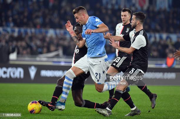 Sergej Milinkovic Savic of SS Lazio competes for the ball with Miralem Pjanic of Juventus during the Serie A match between SS Lazio and Juventus at...
