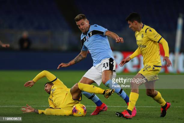 Sergej Milinkovic Savic of SS Lazio competes for the ball with players of Hellas Verona during the Serie A match between SS Lazio and Hellas Verona...