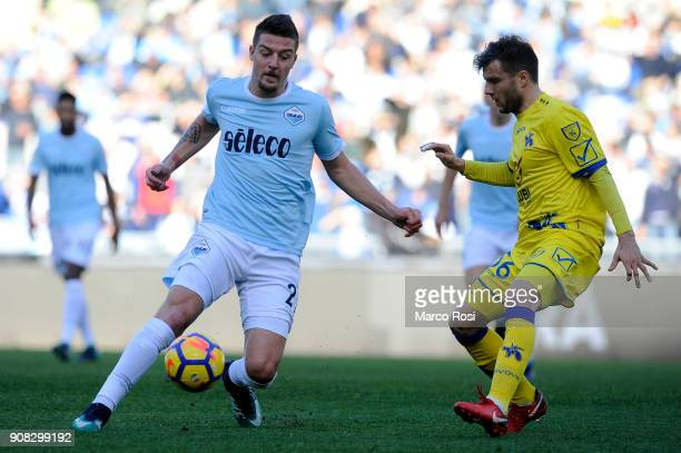 Sergej Milinkovic Savic of SS Lazio competes for the ball with Perparim Hetemaj of AC Chievo Verona during the Serie A match between SS Lazio and AC...