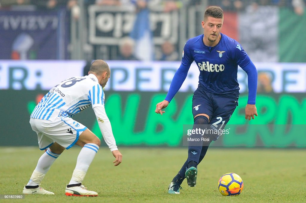 Sergej Milinkovic Savic of SS Lazio competes for the ball with Pasquale Schiattarella Spal during the serie A match between Spal and SS Lazio at Stadio Paolo Mazza on January 6, 2018 in Ferrara, Italy.