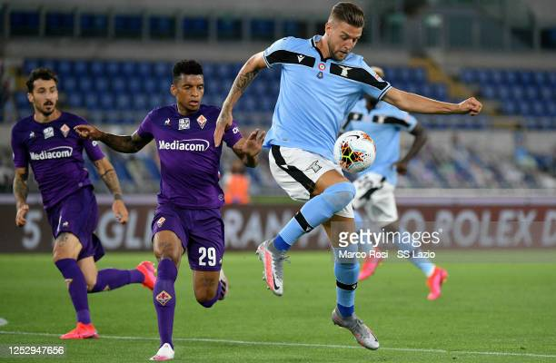 Sergej Milinkovic Savic of SS Lazio controls the ball against Henrique Dalbert of ACF Fiorentina during the Serie A match between SS Lazio and ACF...