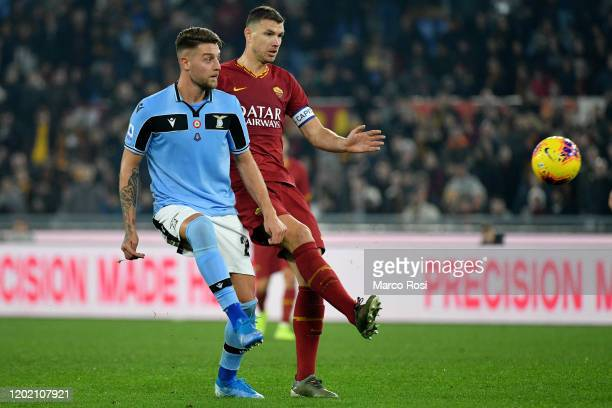 Sergej Milinkovic Savici of SS Lazio compete for the ball with Edin Dzeko of AS Roma during the Serie A match between AS Roma and SS Lazio at Stadio...