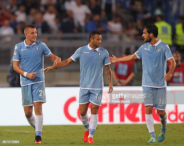 Sergej Milinkovic with his teammates Felipe Anderson and Marco Parolo of SS Lazio celebrates after scoring the opening goal during the Serie A match...