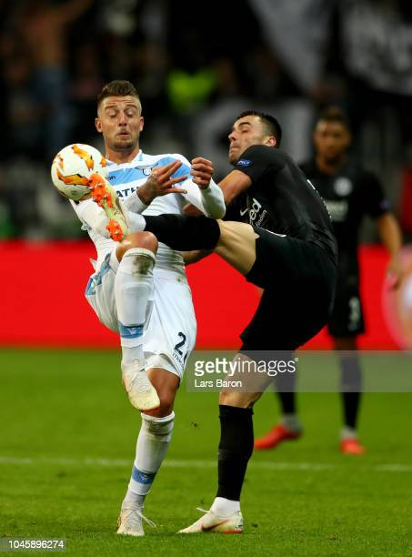 Sergej MilinkovicSavic of Lazio battles for possession with Filip Kostic of Eintracht Frankfurt during the UEFA Europa League Group H match between...