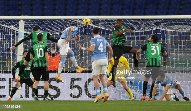 Sergej Milinkovic-Savic of Lazio scores their sides first goal pasy Andrea Consigli of US Sassuolo during the Serie A match between SS Lazio and US...