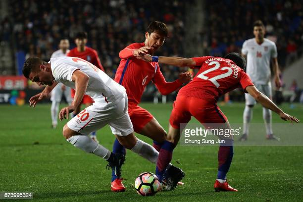 Sergej MilinkovicSavic of Serbia competes for the ball with Kwon ChangHoon of South Korea during the international friendly match between South Korea...