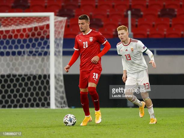 Sergej Milinkovic-Savic of Serbia controls the ball before Zsolt Kalmar of Hungary during the UEFA Nations League group stage match between Hungary...