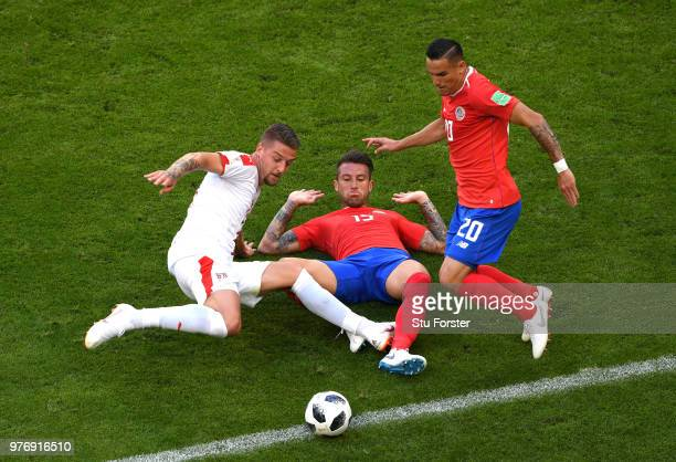 Sergej MilinkovicSavic of Serbia is challenged by Francisco Calvo and David Guzman of Costa Rica during the 2018 FIFA World Cup Russia group E match...
