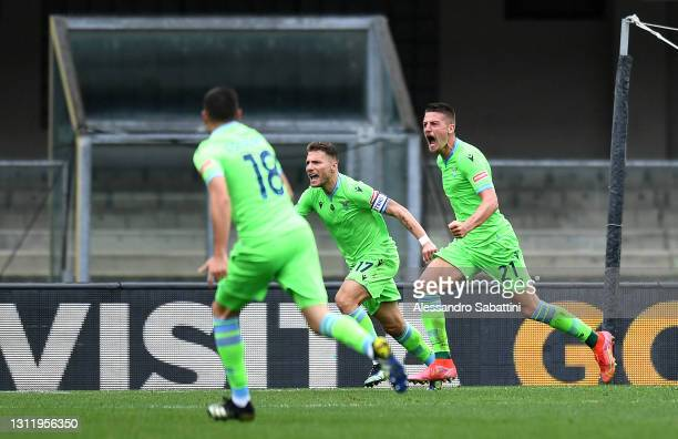 Sergej Milinkovic-Savic of S.S. Lazio celebrates with Ciro Immobile after scoring their side's first goal during the Serie A match between Hellas...