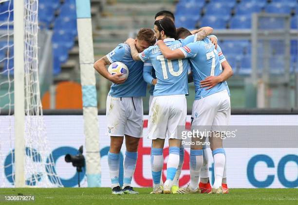 Sergej Milinkovic-Savic of S.S. Lazio celebrates with team mates after scoring their side's first goal during the Serie A match between SS Lazio and...