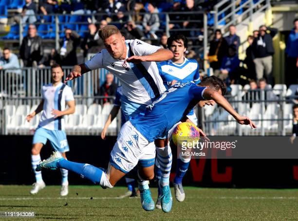 Sergej MilinkovicSavic of SS LAZIO competes for the ball with Ales Mateju of Brescia Calcio FC during the Serie A match between Brescia Calcio FC and...