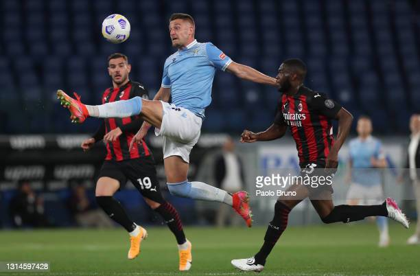 Sergej Milinkovic-Savic of SS Lazio controls the ball while under pressure from Fikayo Tomori of A.C. Milan during the Serie A match between SS Lazio...