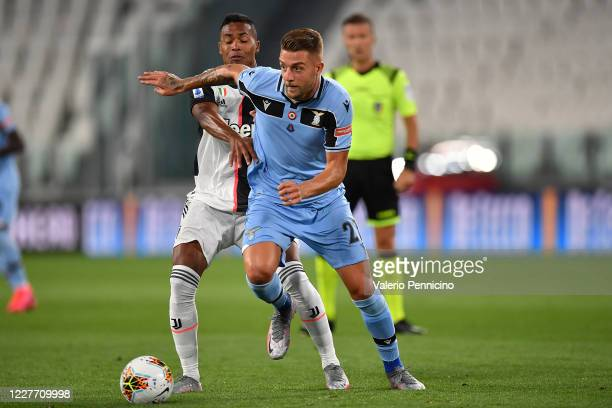 Sergej Milinkovic-Savic of SS Lazio is challenged by Alex Sandro of Juventus during the Serie A match between Juventus and SS Lazio at Allianz...