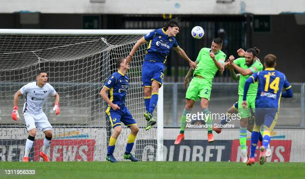 Sergej Milinkovic-Savic of S.S. Lazio scores their side's first goal past Marco Silvestri of Hellas Verona during the Serie A match between Hellas...