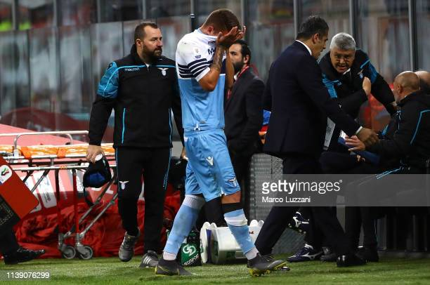 Sergej MilinkovicSavic of SS Lazio walk off with an injury during the TIM Cup match between AC Milan and SS Lazio at Stadio Giuseppe Meazza on April...