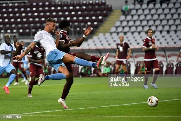 Sergej Milinković-Savić of SS Lazio kicks the ball against Ola Aina of Torino during the Serie A match between Torino FC and SS Lazio at Stadio...
