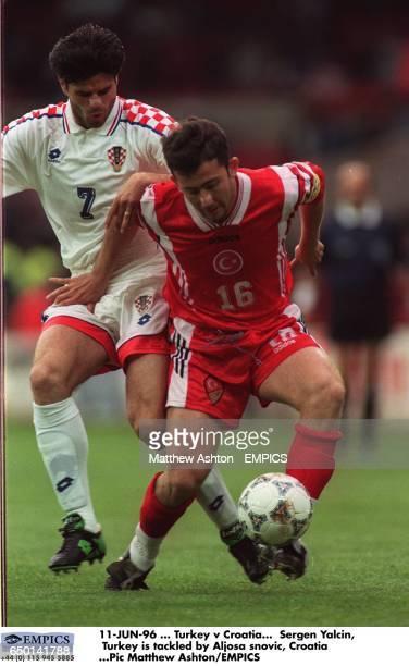 Sergen Yalcin Turkey is tackled by Aljosa Asanovic Croatia