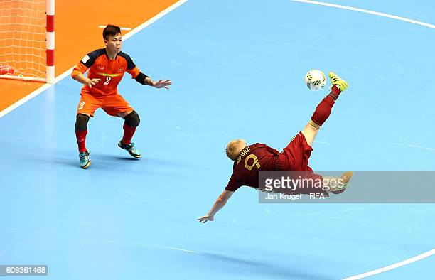 Sergey Abramov of Russia attempts an overhead kick at goal during the FIFA Futsal World Cup round of 16 match between Russia and Vietnam at Coliseo...