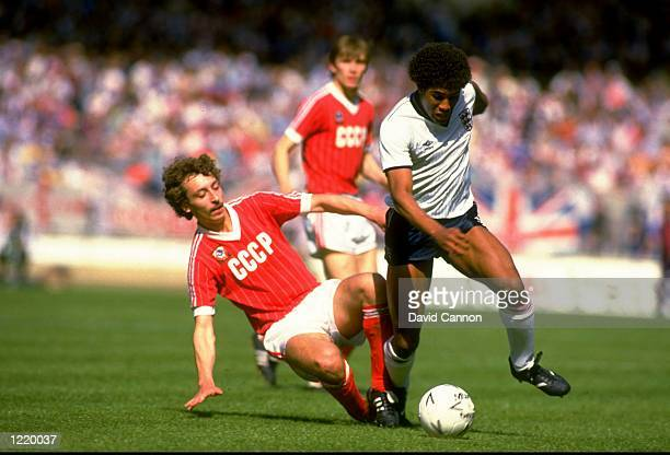 Sergey Aleinikov of USSR slides in to tackle John Barnes of England during the international match played at Wembley Stadium in London. USSR won the...
