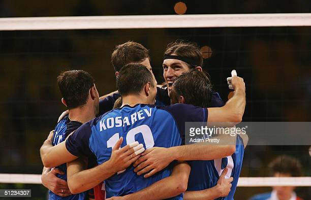 Sergey Baranov of Russia and teammates celebrate during the men's indoor Volleyball bronze medal match against the United States on August 29, 2004...