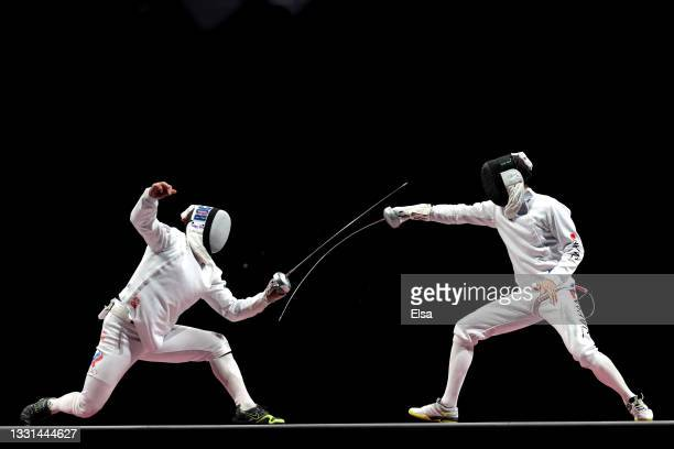 Sergey Bida of Team ROC competes against Masaru Yamada of Team Japan during the Men's Épée Fencing Team Gold Medal Match on day seven of the Tokyo...