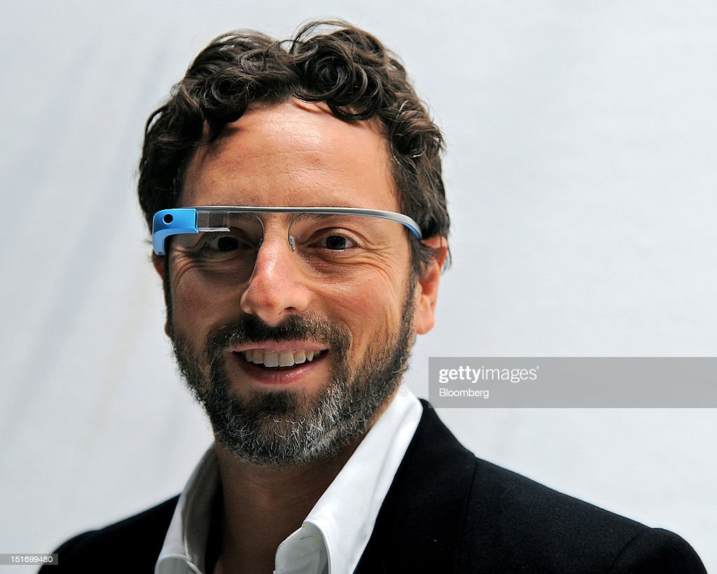 Sergey Brin, co-founder of Google Inc., stands for a photograph while wearing Project Glass internet glasses at the Diane Von Furstenberg fashion show in New York, U.S., on Sunday, Sept. 9, 2012. Google Inc., owner of the world's most popular search engine, will sell eyeglass-embedded computers to consumers by 2014 after incorporating feedback from developers, said Brin. Photographer: Peter Foley/Bloomberg via Getty Images
