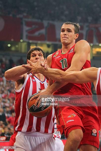 Sergey Bykov, #10 of Lokomotiv Kuban Krasnodar competes with Boban Marjanovic, #13 of Crvena Zvezda Telekom Belgrade during the 2013-2014 Turkish...
