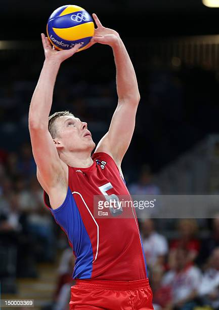 Sergey Grankin of Russia sets the ball in the third set against Poland during the Men's Volleyball quarterfinals on Day 12 of the London 2012 Olympic...