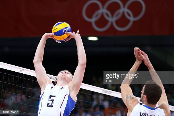 Sergey Grankin of Russia sets up a spike for Alexander Volkov of Russia against Bulgaria during the Men's Volleyball Semifinals on Day 14 of the...