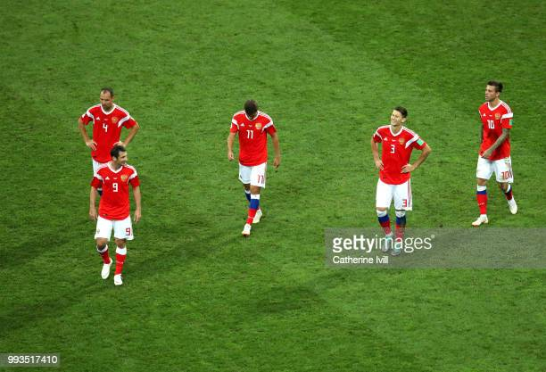 Sergey Ignashevich Alan Dzagoev Aleksandr Erokhin Ilya Kutepov and Fedor Smolov of Russia walk away dejected after the second Croatia goal scored by...