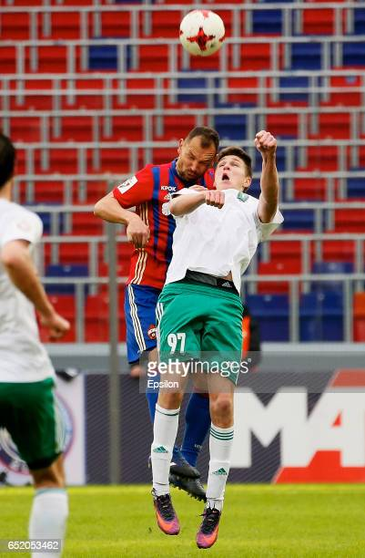Sergey Ignashevich of PFC CSKA Moscow challenged by Alexander Sobolev of FC Tom Tomsk during the Russian Premier League match between PFC CSKA Moscow...