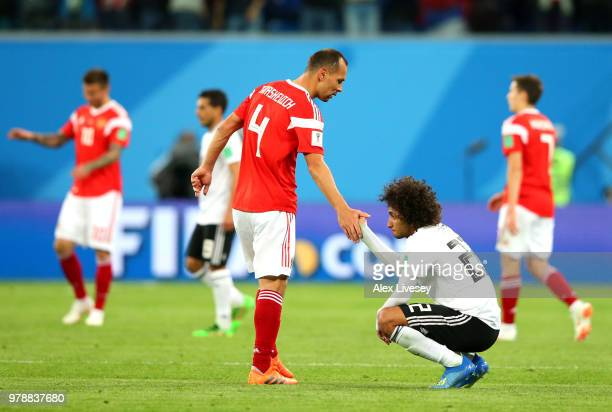 Sergey Ignashevich of Russia consoles Amr Warda of Egypt following Russia victory in the 2018 FIFA World Cup Russia group A match between Russia and...