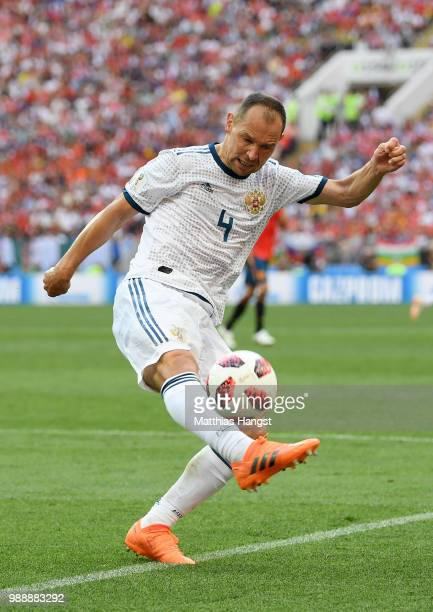 Sergey Ignashevich of Russia controls the ball during the 2018 FIFA World Cup Russia Round of 16 match between Spain and Russia at Luzhniki Stadium...