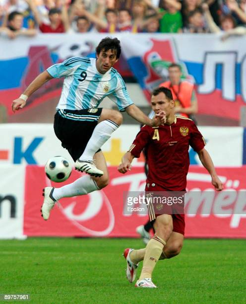 Sergey Ignashevich of Russia fights for the ball with Diego Milito of Argentina during the international friendly match between Russia and Argentina...