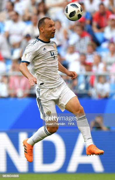 Sergey Ignashevich of Russia heads the ball during the 2018 FIFA World Cup Russia group A match between Uruguay and Russia at Samara Arena on June 25...
